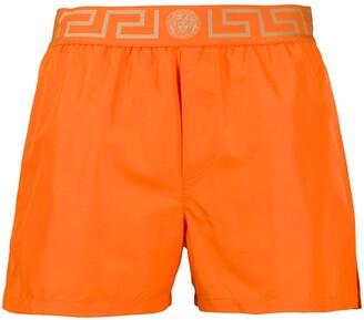 Versace Greca-waistband swim shorts