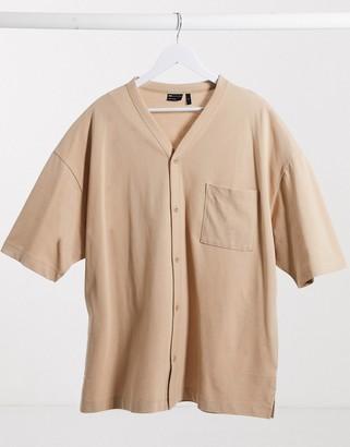 ASOS DESIGN oversized button through baseball shirt with pocket in beige