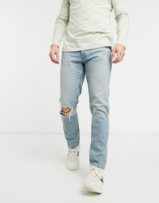 ASOS DESIGN low rise slim jeans in vintage mid 90's wash with knee rip