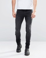 Asos Super Skinny Longline Stacker Jeans With Abrasions In Black