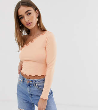 Asos DESIGN Petite one shoulder long sleeve crop t-shirt with lettuce hem in coral-Pink