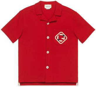 Gucci Children's cotton polo shirt with G patch