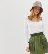 Bershka patched mini skirt in green