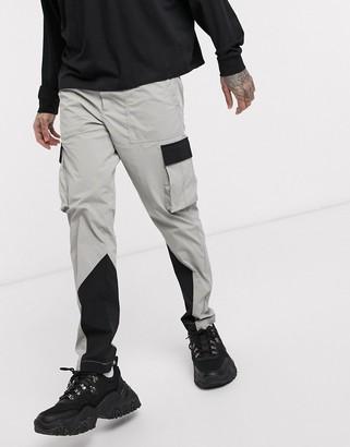 Jack and Jones Core nylon colour block cargo trousers in grey