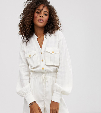 Asos Tall ASOS DESIGN Tall button front casual textured tie waist utility playsuit with pocket detail