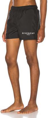 Givenchy Flat Classic Swim Short in Black | FWRD