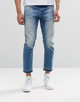 Asos Slim Cropped Jeans With Abrasions In Mid Blue