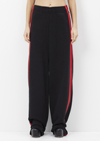Vetements black oversized sweatpants red stripes