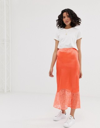 Asos DESIGN bias cut satin midi slip skirt with lace hem in neon orange