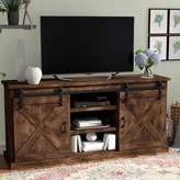 Laurèl Foundry Modern Farmhouse Clair TV Stand for TVs up to 75 inches Foundry Modern Farmhouse Color: Aged Whiskey