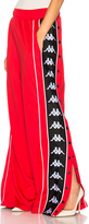 Faith Connexion x Kappa Tear Away Pants in Red.