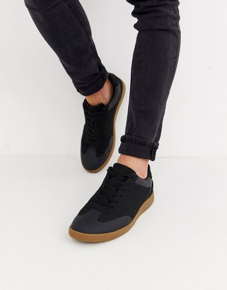 Asos DESIGN lace up sneakers in black faux suede with gum sole