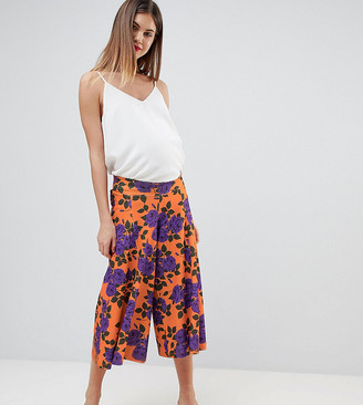 Asos DESIGN Maternity low rise bump band wide leg culottes with flowing hem in orange floral print