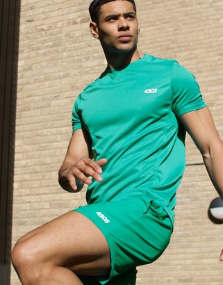 Asos 4505 training shorts in mid length in green