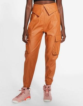 Jordan Nike CTR faux leather utility pants in tan