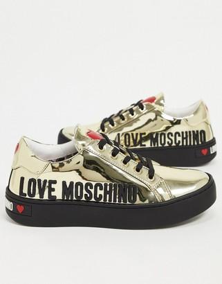 Love Moschino metallic logo trainers in gold