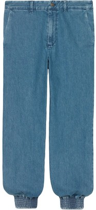 Gucci marble washed denim track pants