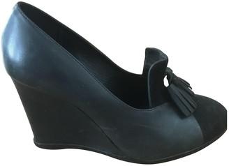 Tila March Black Leather Heels