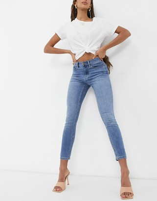 Calvin Klein Jeans mid rise skinny jeans in mid wash