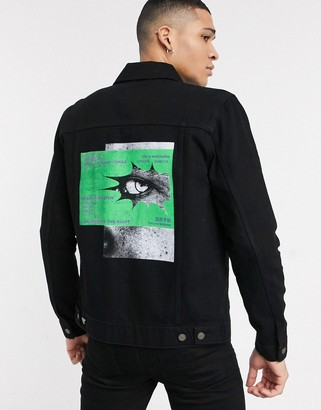 ASOS DESIGN denim jacket in black with back print