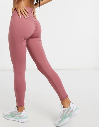 In The Style x Courtney Black activewear ruched bum leggings in pink