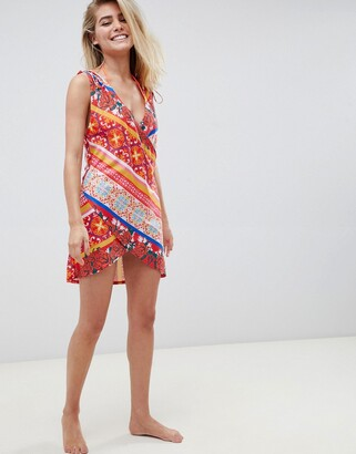 ASOS DESIGN floral postcard print wrap jersey beach cover up
