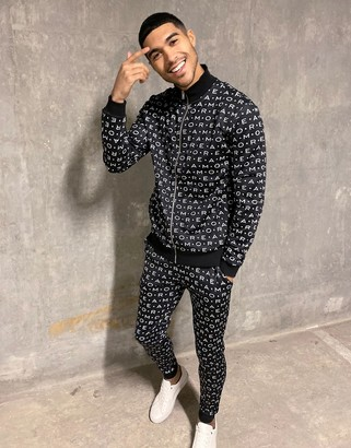 Asos DESIGN tracksuit with track top & tapered sweatpants in monogram print