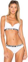 Calvin Klein Underwear Seamless Logo Demi Multiway Bra in White. - size 32A (also in 32B,32C,32D,34A,34C)
