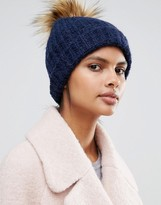 Whistles Faux Pom Beanie in Navy