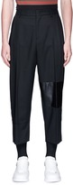 McQ 'Taigen' cropped lambskin leather panel virgin wool pants