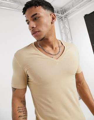 ASOS DESIGN muscle fit t-shirt with deep v neck in beige