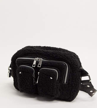 Nunoo Ellie cross body bag with front pockets in black teddy