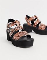 Asos Design DESIGN Helper chunky mid-heeled sandals in pink snake