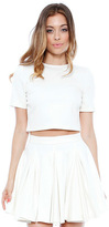 taylor swift  Who made  Taylor Swifts short sleeve crop top, jewelry, and pleated white skirt?