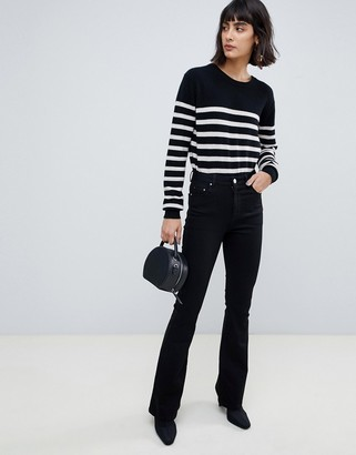 Asos Design DESIGN bell flare jeans in clean black with pressed crease