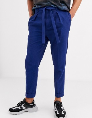 ASOS DESIGN tapered crop trousers with turn up in navy