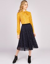 Louche Pleated Lace Midi Skirt