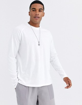 ASOS DESIGN relaxed long sleeve raglan t-shirt with high neck in white