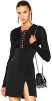 David Koma Lace Up Long Sleeve Knit Bodysuit in Black.