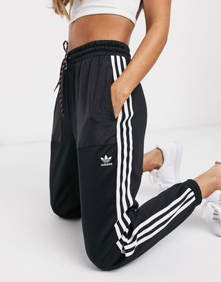 adidas Bellista three stripe cuffed joggers in black
