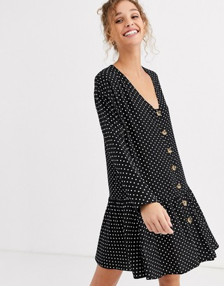 ASOS DESIGN swing trapeze mini dress with pep hem in spot