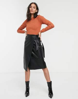 Monki wrap midi leather look skirt in black