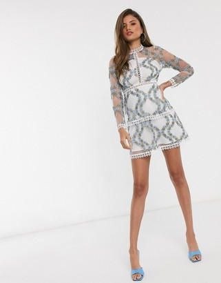Asos DESIGN long sleeve tiered mini dress in blue embroidered floral mesh in white base