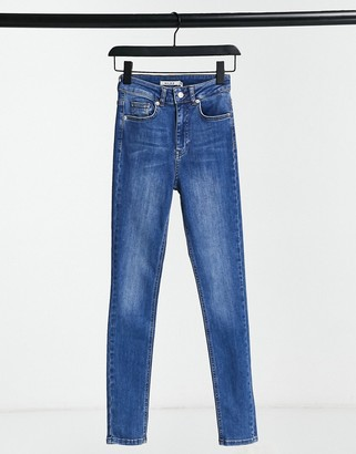 NA-KD skinny high waist jeans in mid blue