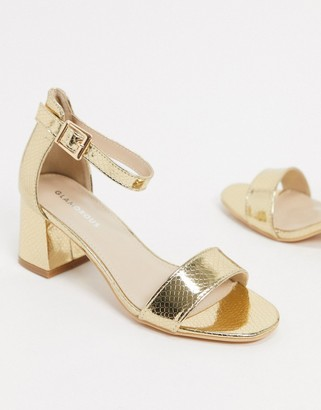 Glamorous mid heeled sandals in lizard embossed gold