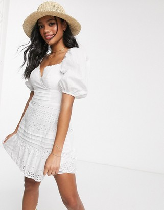 ASOS DESIGN wrap front broderie mini dress with puff sleeves in white