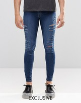 Cheap Monday Low Spray Slash Extreme Super Skinny Jeans In Mid Blue Extreme Rips