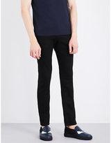 Fendi Metal-detailed Slim-fit Tapered Jeans