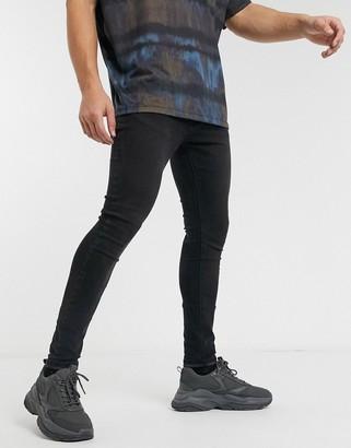 Criminal Damage essential skinny jeans in black stone wash