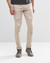Asos Skinny Jeans With Extreme Rips In Stone